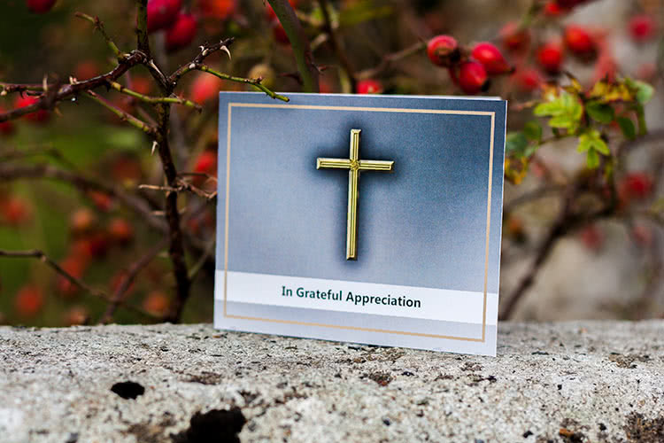 Thank You / Acknowledgement card with golden cross on the front .
