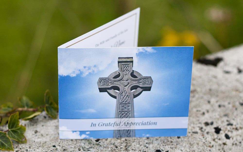Folding funeral thank you card with stone Celtic cross on the front.