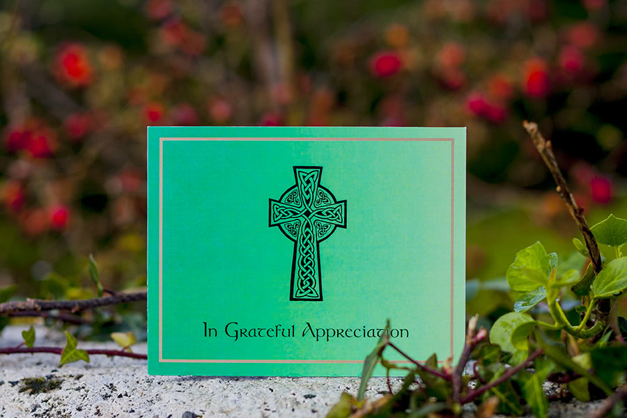 AC7 acknowledgement card design, double sided. Green background, large black Celtic cross.