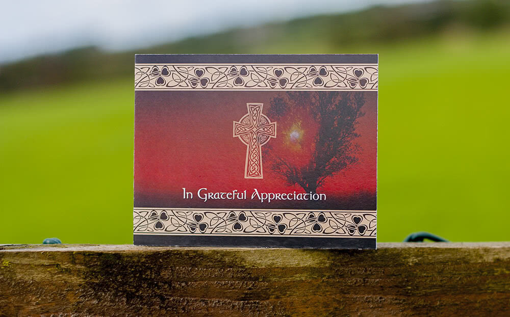 Card with Celtic cross and Irish floral pattern