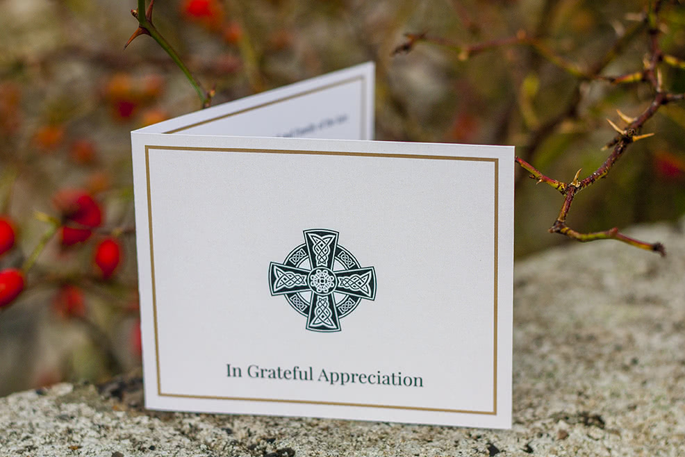 Folding acknowledgement card with Celtic cross on the front