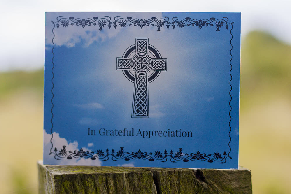 Funeral thank you card with black cross on the front