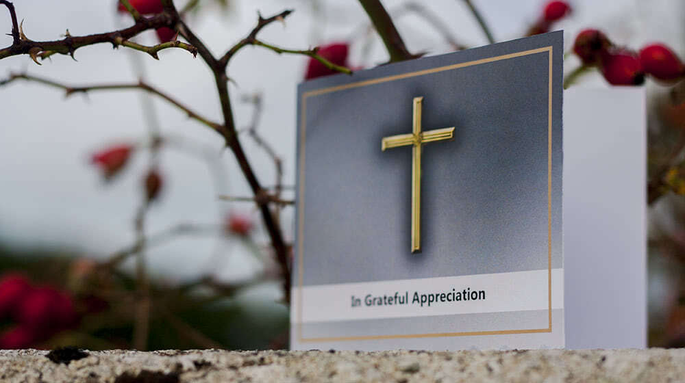 "Thank you card with large golden cross and ""In Grateful Appreciation"" writing on the front"