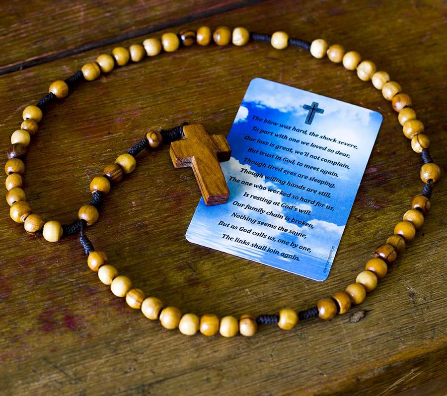 Rosary around wallet card with a poem