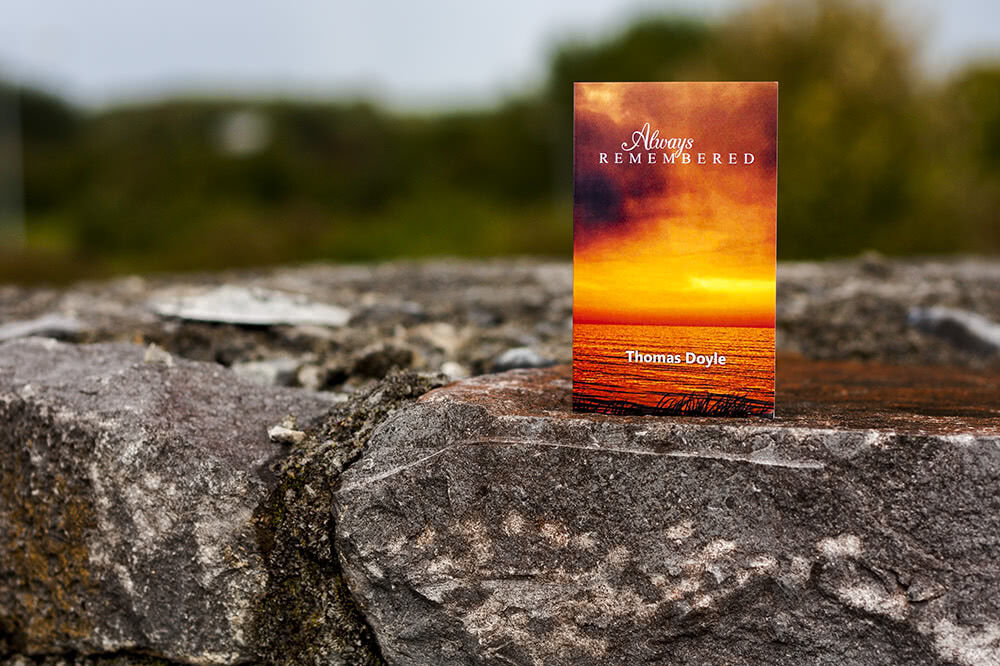 Scenic folding memorial card with sunset motive